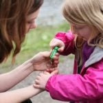Children love to discover the world around them while geocaching. Photo courtesy of geocaching.com.