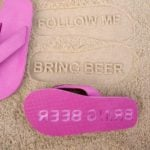 Personalized flip flops are a fun travel tech gadget.